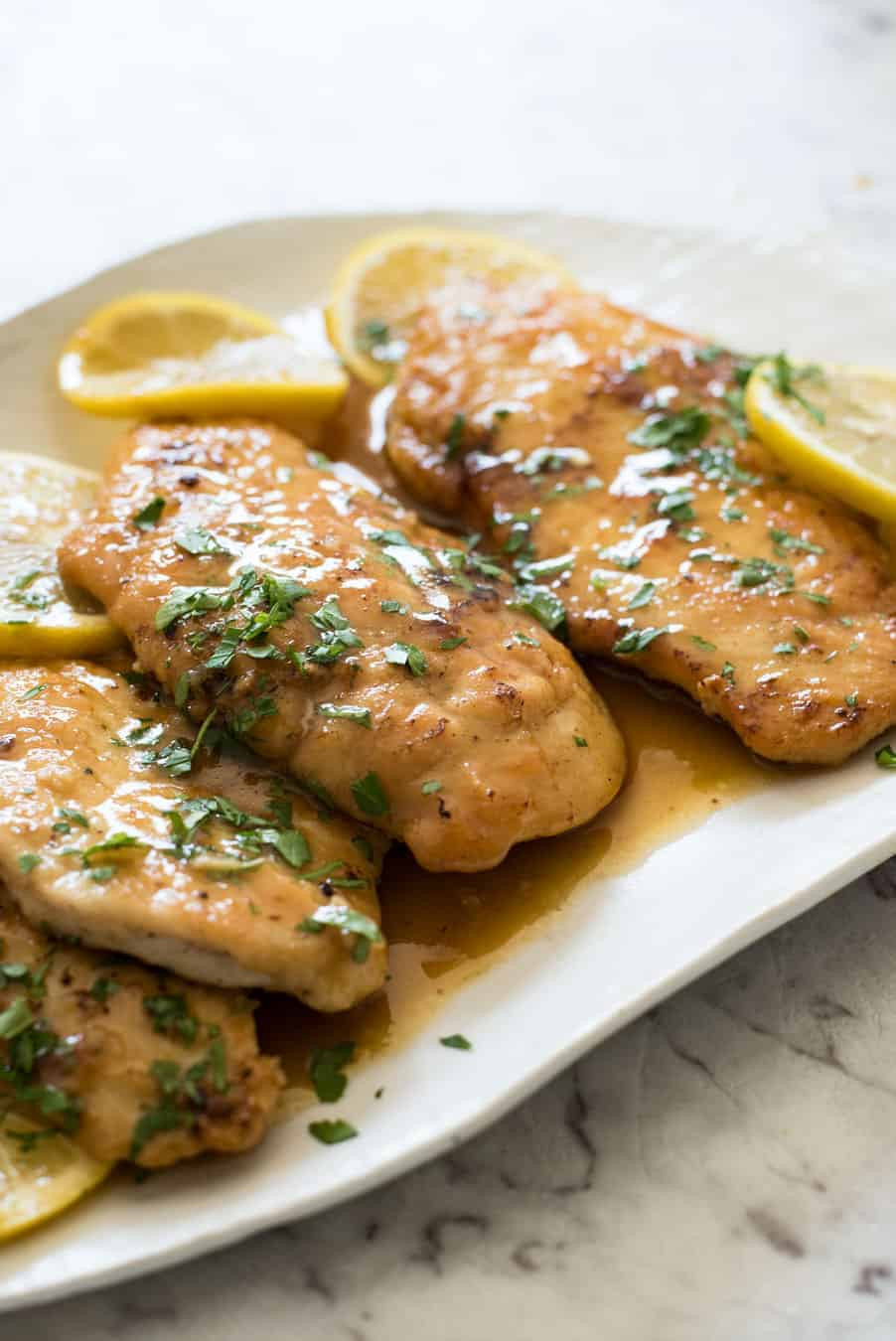 Honey Lemon Chicken - Golden brown chicken breast with a gorgeous honey lemon sauce. On the table in 15 minutes! recipetineats.com